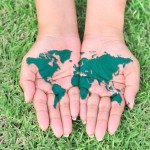 Open Hands with World Map